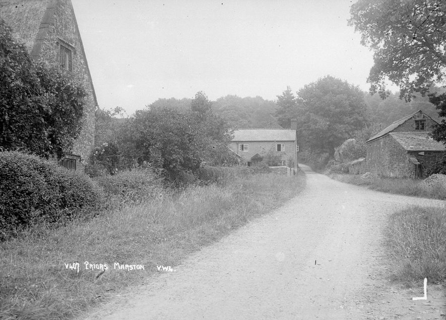 Country road with barns and a cottage, Priors Marston.  1926 |  IMAGE LOCATION: (Warwickshire County Record Office)