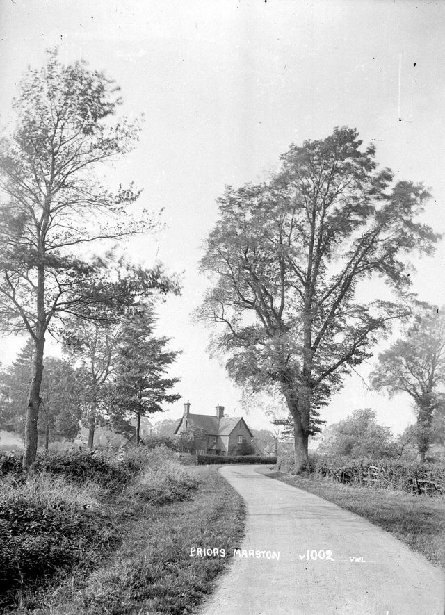 Country road with cottages in the distance, Priors Marston.  1940s |  IMAGE LOCATION: (Warwickshire County Record Office)