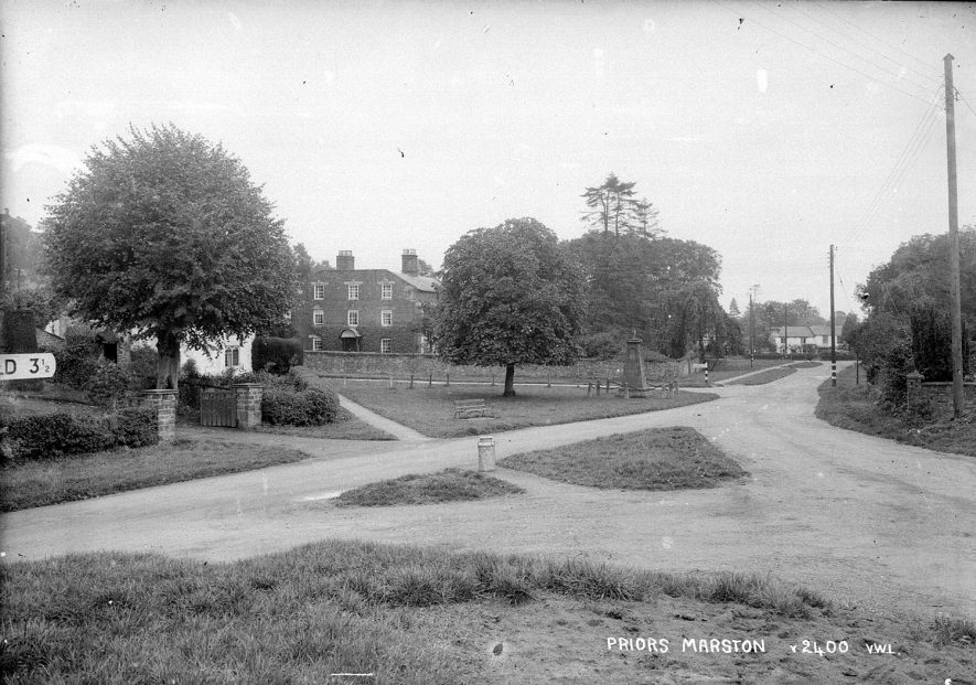 A village scene near the war memorial in Priors Marston.  1950s |  IMAGE LOCATION: (Warwickshire County Record Office)