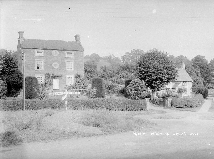 Large detached house and cottage in Priors Marston.  1950s [The large house is High House with Swiss Cottage to the right] |  IMAGE LOCATION: (Warwickshire County Record Office)