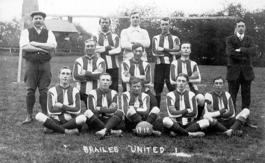 Brailes United football team photograph taken on playing field with church in the background.  1912 |  IMAGE LOCATION: (Warwickshire County Record Office)