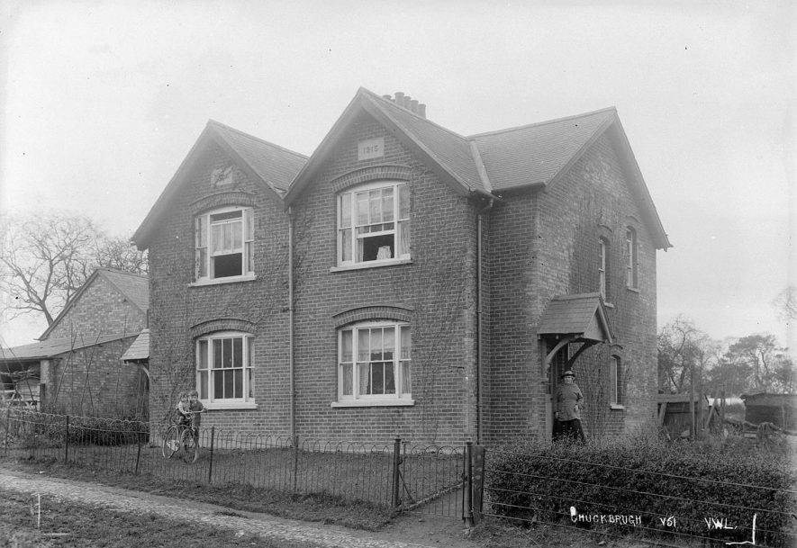 Pair of cottages in Lower Shuckburgh.  1930s |  IMAGE LOCATION: (Warwickshire County Record Office)