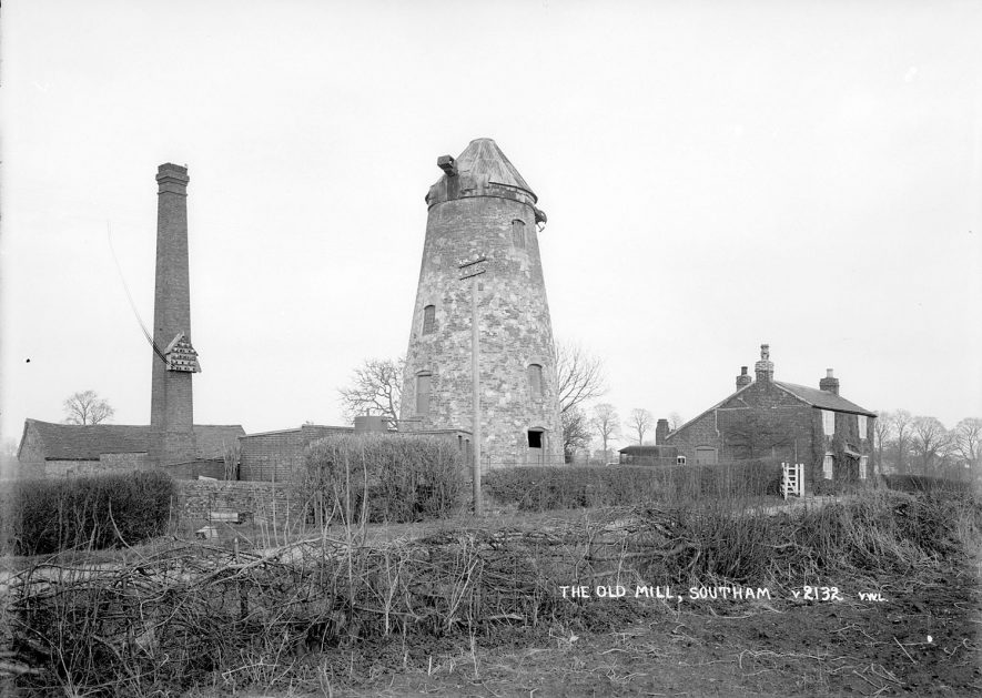 Disused windmill, chimney and cottage at Southam.  1930s |  IMAGE LOCATION: (Warwickshire County Record Office)