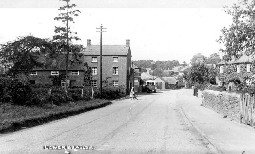 Road in Lower Brailes with houses and cottages on either side.  1930s |  IMAGE LOCATION: (Warwickshire County Record Office)