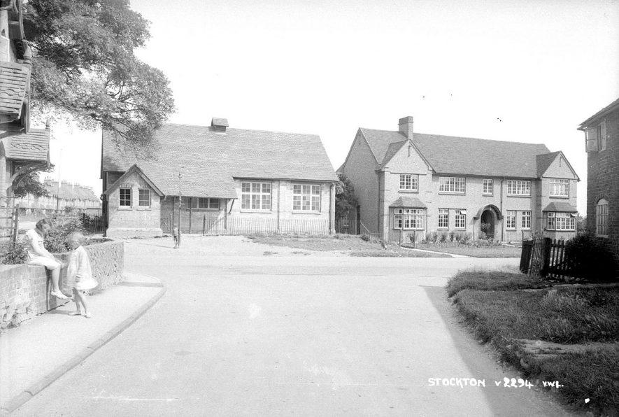 Village houses in Stockton. 1930s[On the left is the village hall, on the right is the Nelson's Working Mens Club. The lane form where the photograph was taken is Post office Lane and the Post office was at the other end of this lane] |  IMAGE LOCATION: (Warwickshire County Record Office)