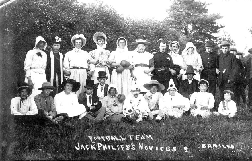 Jack Philipp's novices football team in fancy dress, Lower Brailles.  1910s |  IMAGE LOCATION: (Warwickshire County Record Office)