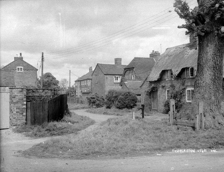 Cottages in an unidentified street in Thurlaston.  1930s  [Street has been identified as Stocks Lane.] |  IMAGE LOCATION: (Warwickshire County Record Office)