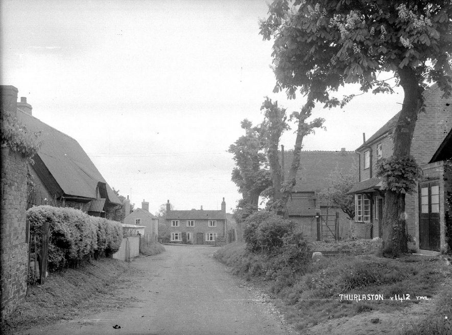 Cottages in Thurlaston with the village hall on the right.  1940s