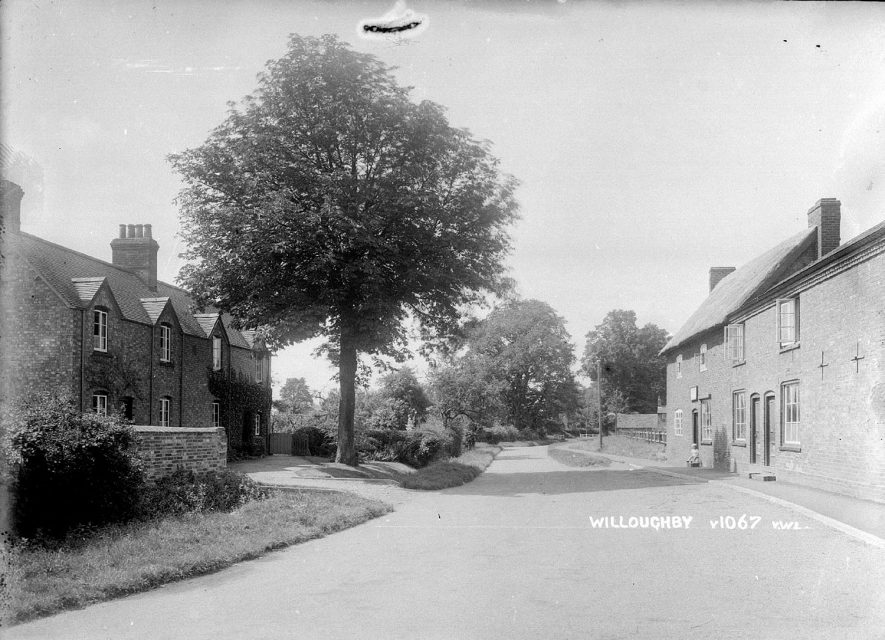 A Willoughby street with cottages and shop front of Thompson & Sons, bakers and grocers at right.  1935 |  IMAGE LOCATION: (Warwickshire County Record Office)