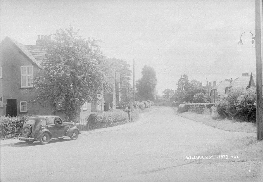 A Willoughby street with houses and a parked car.  1935 |  IMAGE LOCATION: (Warwickshire County Record Office)