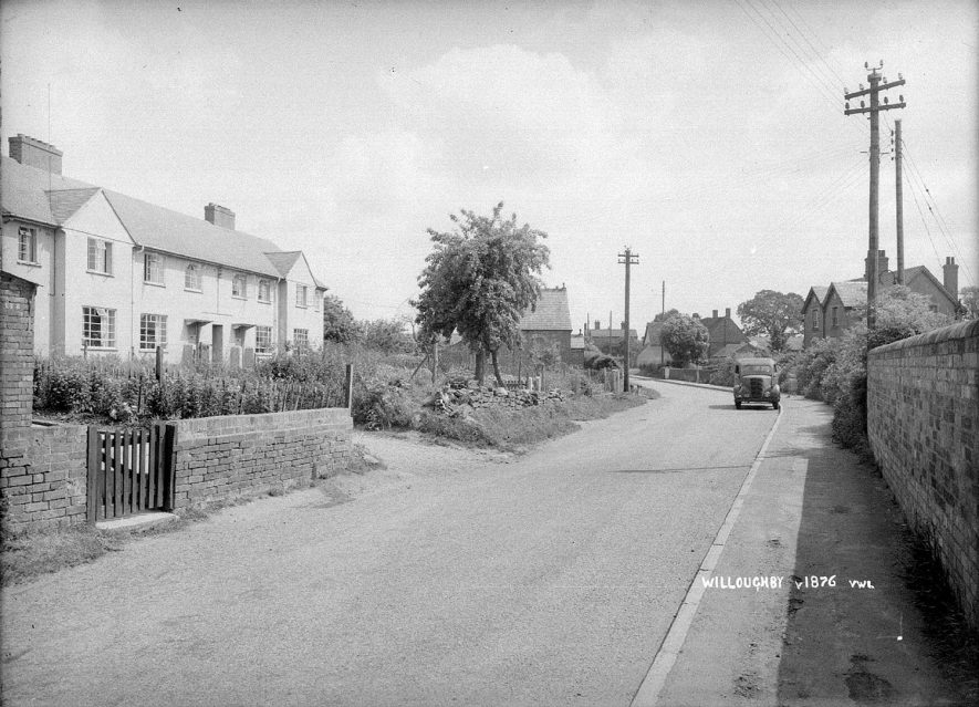 A road in Willoughby with terraced housing.  1935 |  IMAGE LOCATION: (Warwickshire County Record Office)