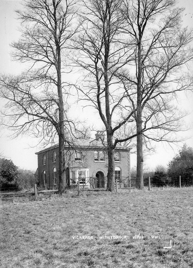 The vicarage seen through trees at Withybrook.  1930s |  IMAGE LOCATION: (Warwickshire County Record Office)