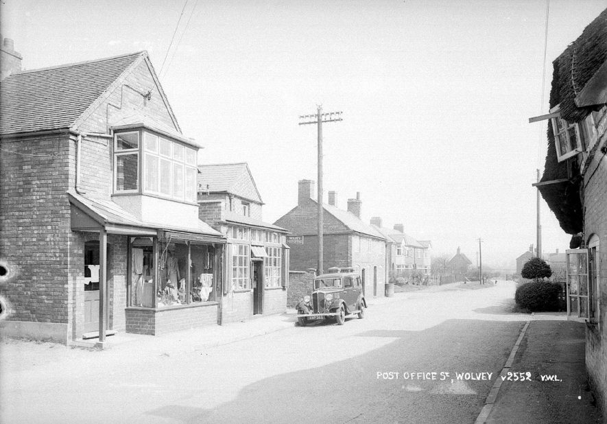The post office with car standing in front in Wolvey.  1950s |  IMAGE LOCATION: (Warwickshire County Record Office)