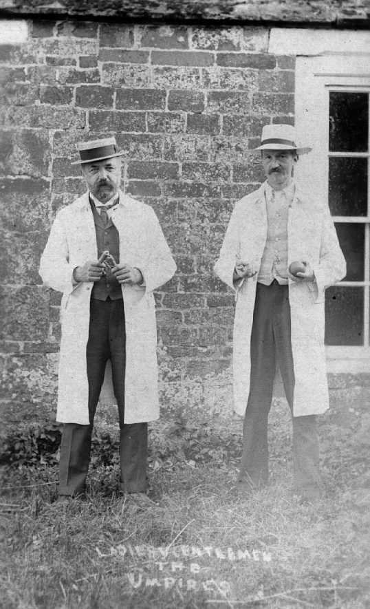 Two cricket umpires holding ball and bails, Lower Brailes.  1908 |  IMAGE LOCATION: (Warwickshire County Record Office)