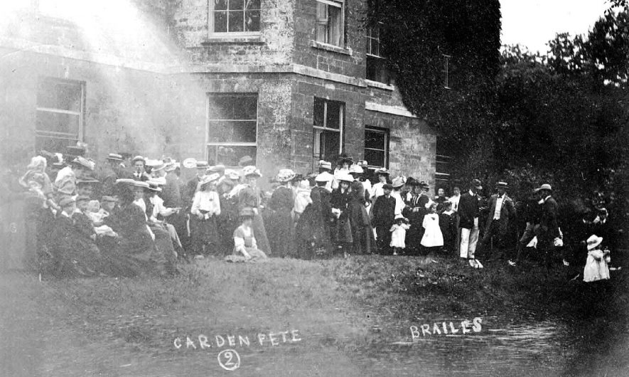 Group photograph outside large house, Lower Brailes, at a garden fete.  1900s |  IMAGE LOCATION: (Warwickshire County Record Office)