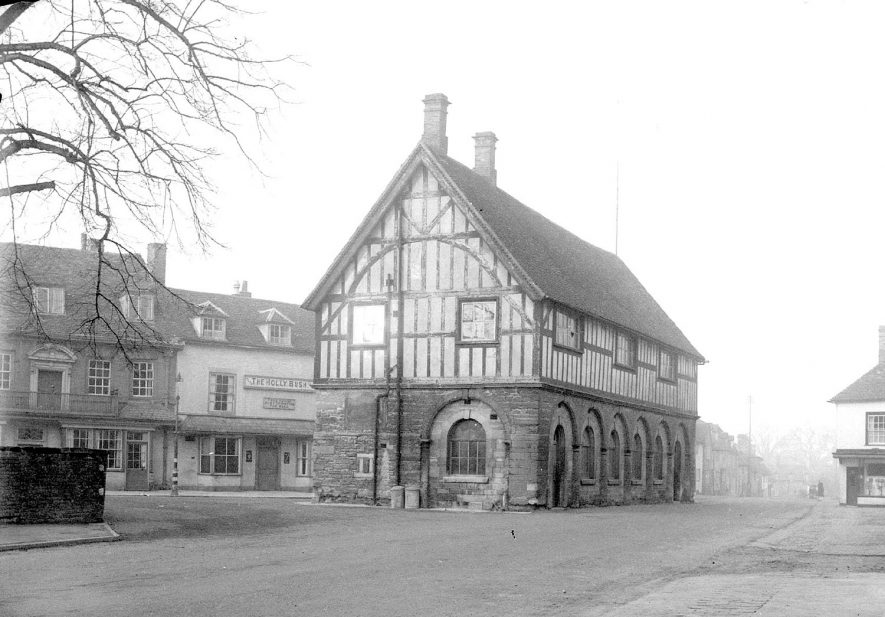 The multi-arched and timber framed Town Hall in Market Place, Alcester.  1920s    IMAGE LOCATION: (Warwickshire County Record Office)