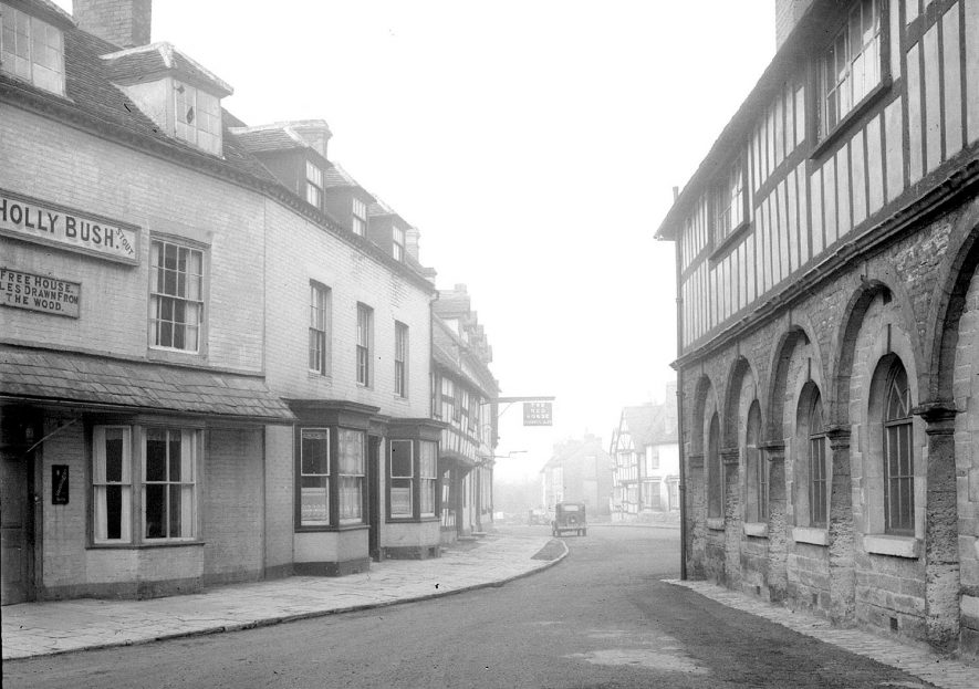 View showing the side of the Town Hall and The Holly Bush Inn, Alcester.  1920s |  IMAGE LOCATION: (Warwickshire County Record Office)