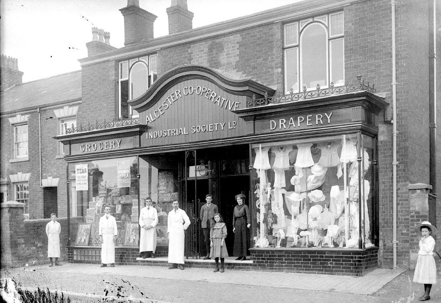 The Co-operative Industrial Society Ltd No 2 shop, Studley, with the assistants standing outside. 1910s |  IMAGE LOCATION: (Warwickshire County Record Office)