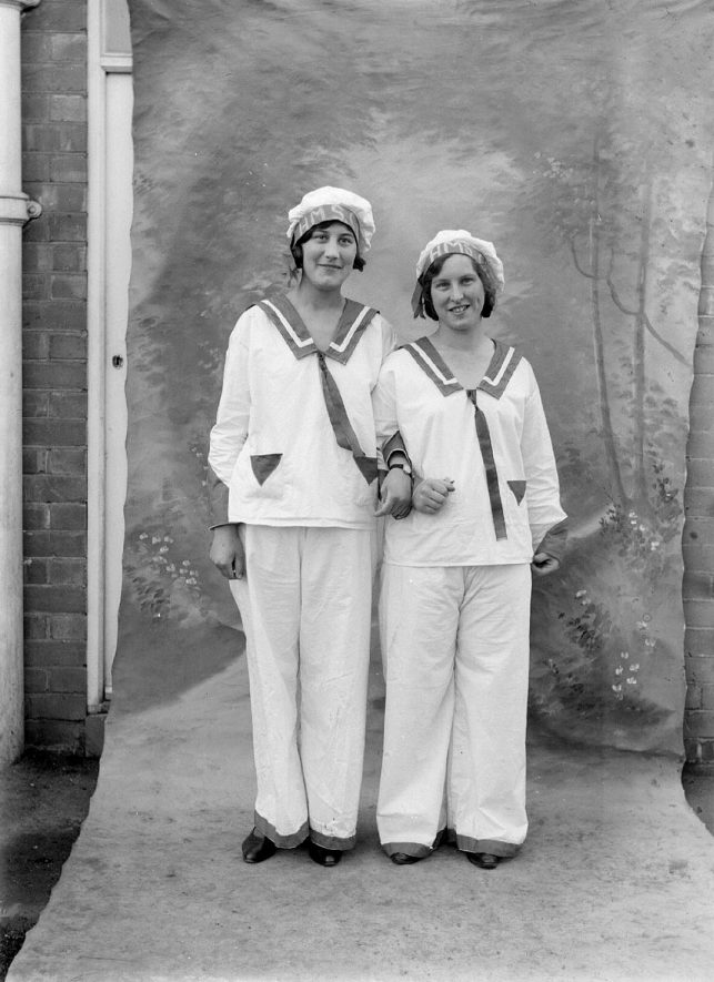 Two women dressed as sailors in the Co-operative Carnival in a photographic studio, Alcester. 1920s |  IMAGE LOCATION: (Warwickshire County Record Office)