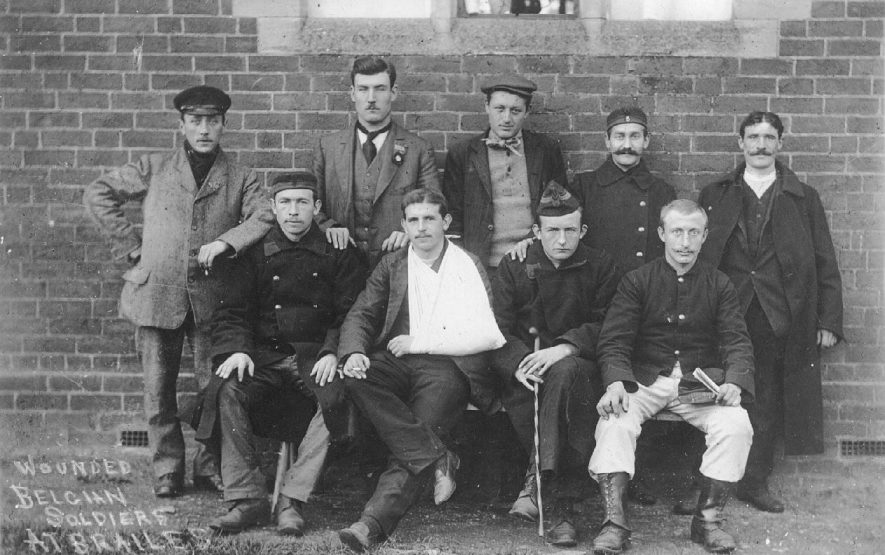 Group of wounded Belgian soldiers outside Red Cross Hospital in the Institute, Lower Brailes.  1914 |  IMAGE LOCATION: (Warwickshire County Record Office)