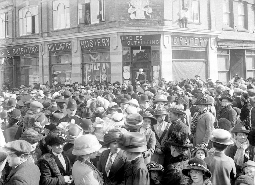 A crowd of people in Alcester High Street, reason unknown.  1930s |  IMAGE LOCATION: (Warwickshire County Record Office)