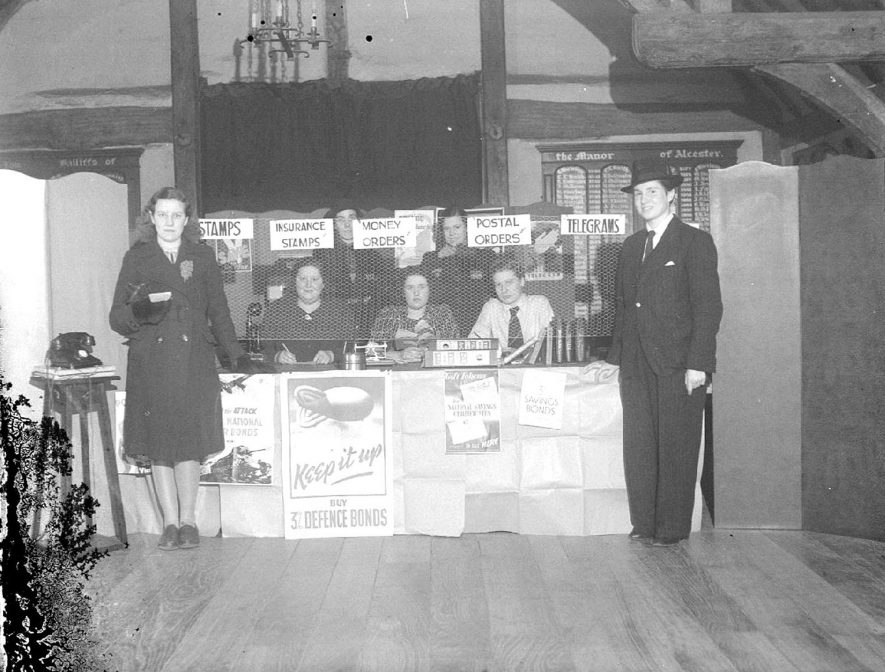 Appears to be a temporary war time Post Office in Alcester Town Hall during World War II.  1940s |  IMAGE LOCATION: (Warwickshire County Record Office)
