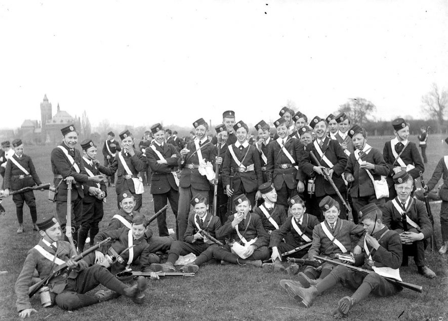 A group of members of the Church Lads'  Brigade, several carrying rifles, in Stratford upon Avon.  1920s