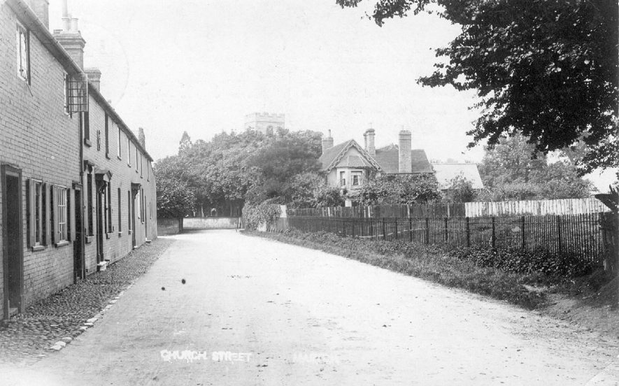 Terraced cottages in Church Street, Marton. The tower of the church is just seen above trees in the background.  1900s |  IMAGE LOCATION: (Warwickshire County Record Office)