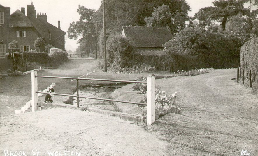 View looking along Brook Street, Wolston, with the brook in the foreground.  1950s |  IMAGE LOCATION: (Warwickshire County Record Office)