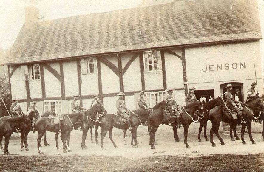 The Yeomanry Cavalry outside Jenson's butchers shop, Wolston.  1900s |  IMAGE LOCATION: (Warwickshire County Record Office)