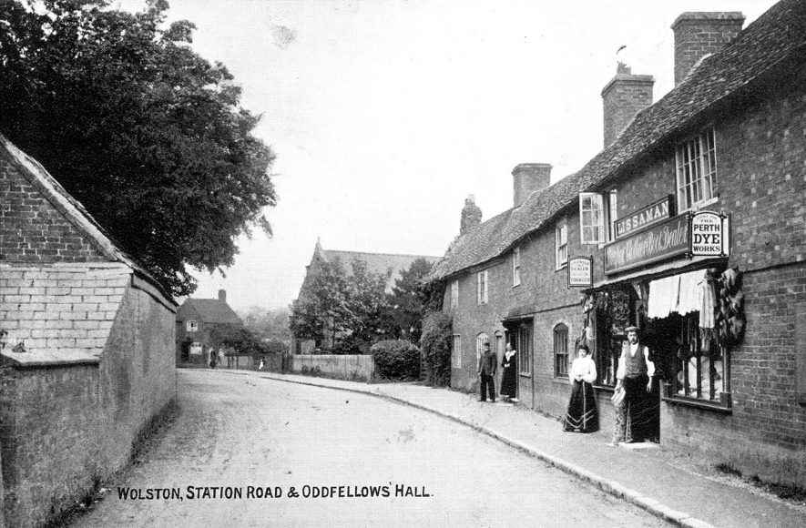 Station Road (now Main Street), Wolston, with Lissaman's drapers shop and the Oddfellows Hall.  1900s |  IMAGE LOCATION: (Warwickshire County Record Office)