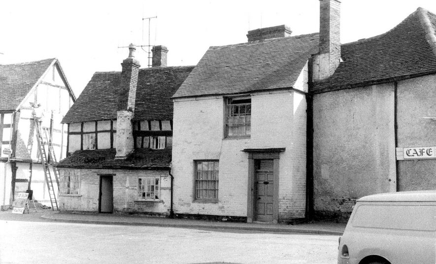 Cottages in Church Street, Alcester, which have now been demolished.  1930s