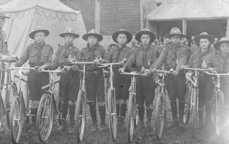 Group of Boy Scouts each with a bicycle, possibly at scout camp, Lower Brailes.  1910s |  IMAGE LOCATION: (Warwickshire County Record Office)