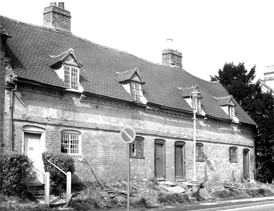 Almshouses in Alcester.  1940s [This picture may have been taken in the late 1960s and not as shown 1940s, because of the broken windows. This photograph is of the Priory Almhouses on Birmingham Road (founded in 1659).] |  IMAGE LOCATION: (Warwickshire County Record Office)