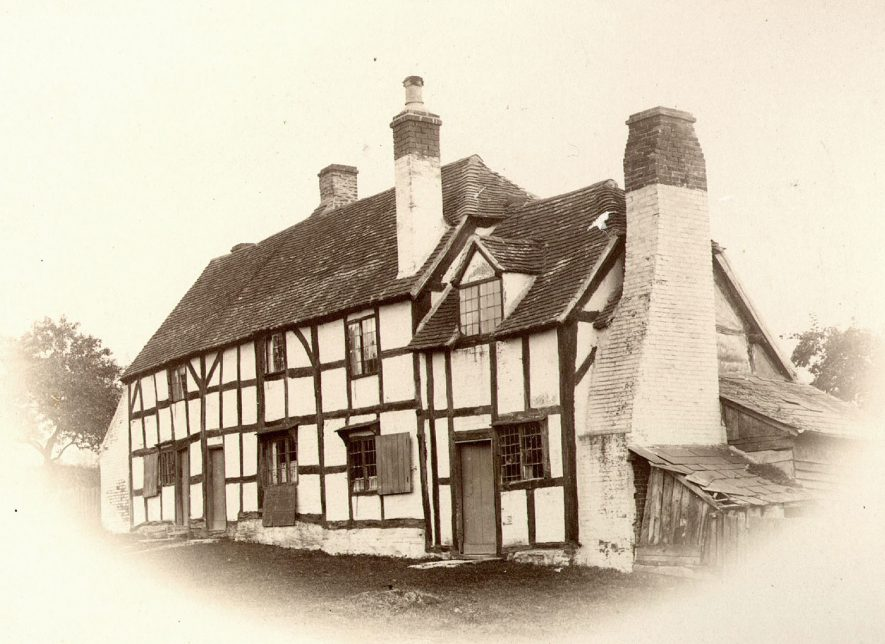 A timber framed house in Wootton Wawen.  1900s |  IMAGE LOCATION: (Warwickshire County Record Office)