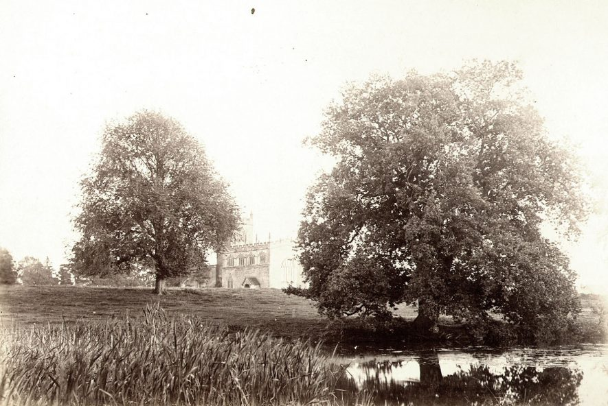St Peter's church, Wootton Wawen, seen across the fields.  1900s |  IMAGE LOCATION: (Warwickshire County Record Office)
