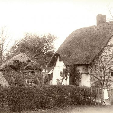 Welford on Avon.  Small thatched and timbered cottage
