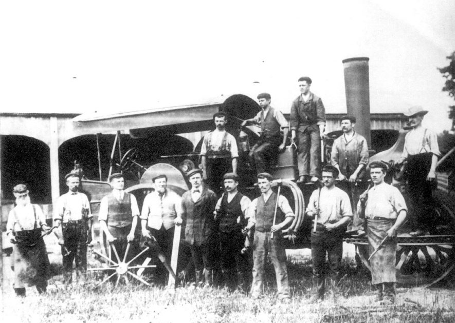Group of Bomford and Evershed agricultural engineering workers standing in front of a steam engine, Salford Priors.  1900s |  IMAGE LOCATION: (Warwickshire County Record Office)