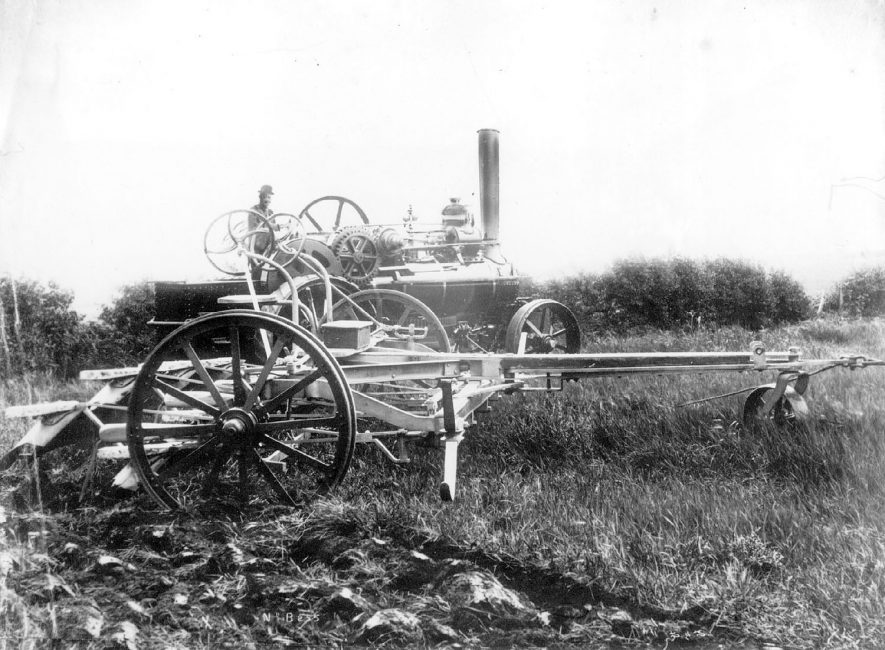 A Fowler eight horse power ploughing engine working an early prototype four-furrow reversible plough, Salford Priors.  c. 1880 |  IMAGE LOCATION: (Warwickshire County Record Office)