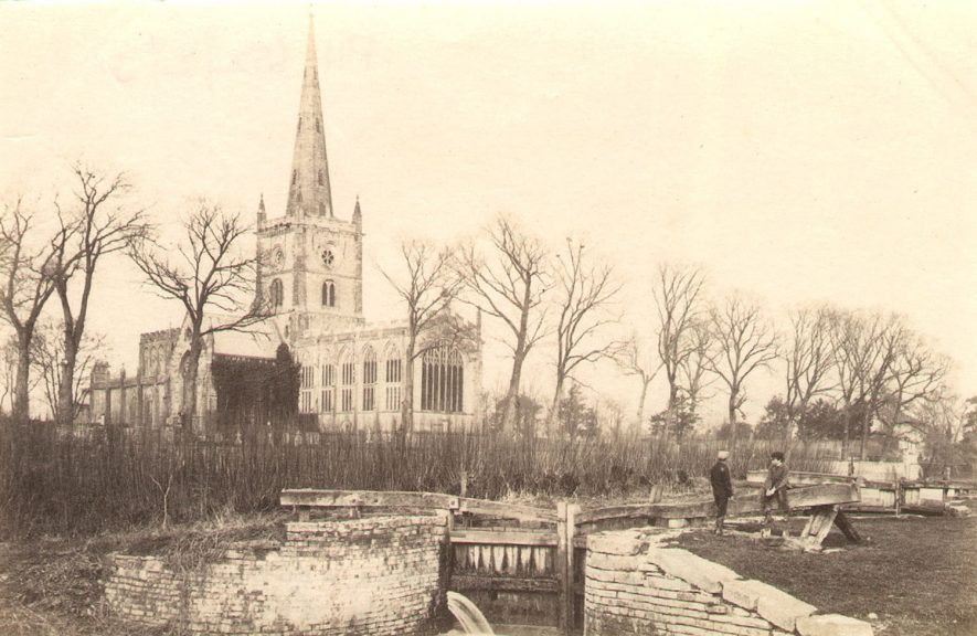 Holy Trinity Church, Stratford upon Avon, seen from the lock gates.  1860s |  IMAGE LOCATION: (Warwickshire County Record Office)
