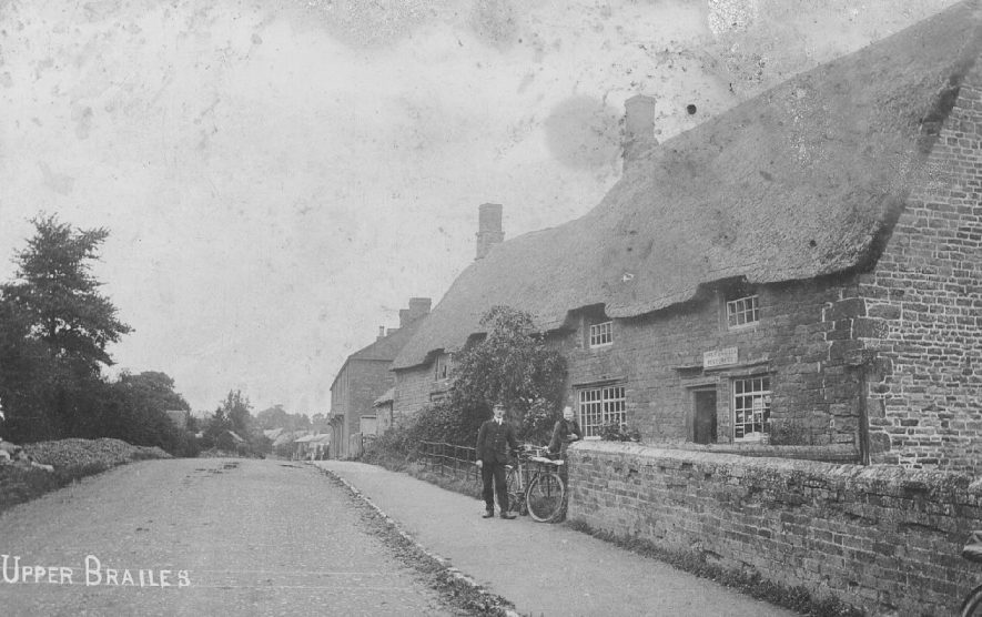 The street, showing the Post Office with a postman and his bicycle outside, Upper Brailes.  1910s |  IMAGE LOCATION: (Warwickshire County Record Office) SCAN DATE: (1/1/908)