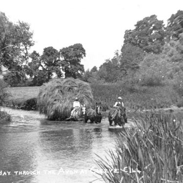 Salford Priors.  Carrying hay through the River Avon