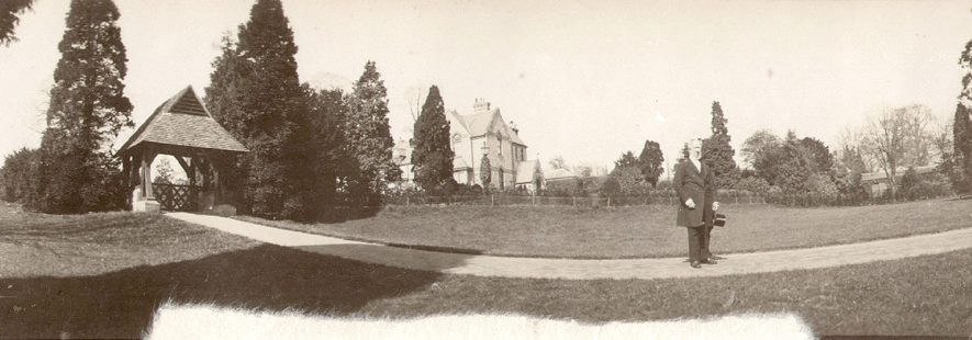 The Rev. B. Stannus standing in front of the lych gate and the rectory at Arrow.  Circa 1900 |  IMAGE LOCATION: (Warwickshire County Record Office) PEOPLE IN PHOTO: Stannus, Revd B