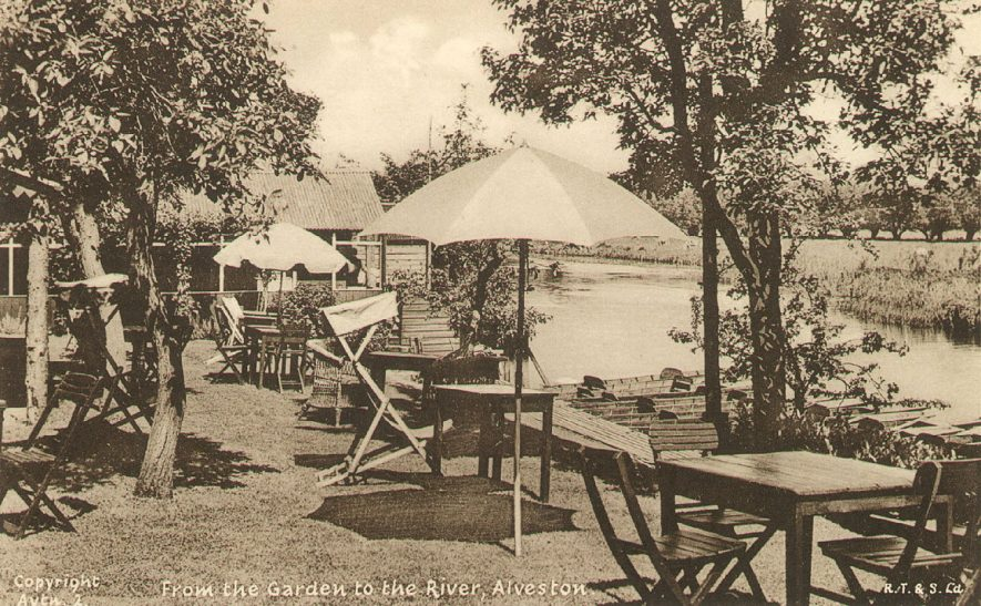View from the garden to the river of what is said to be Ferry House tea garden and boat hire, Alveston.  1930s |  IMAGE LOCATION: (Warwickshire County Record Office)