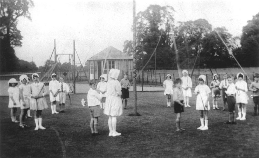 Ashorne children about to dance around the maypole.  1930s |  IMAGE LOCATION: (Warwickshire County Record Office)