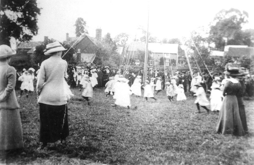 Girls dancing around the maypole in Ashorne.  1910 |  IMAGE LOCATION: (Warwickshire County Record Office)