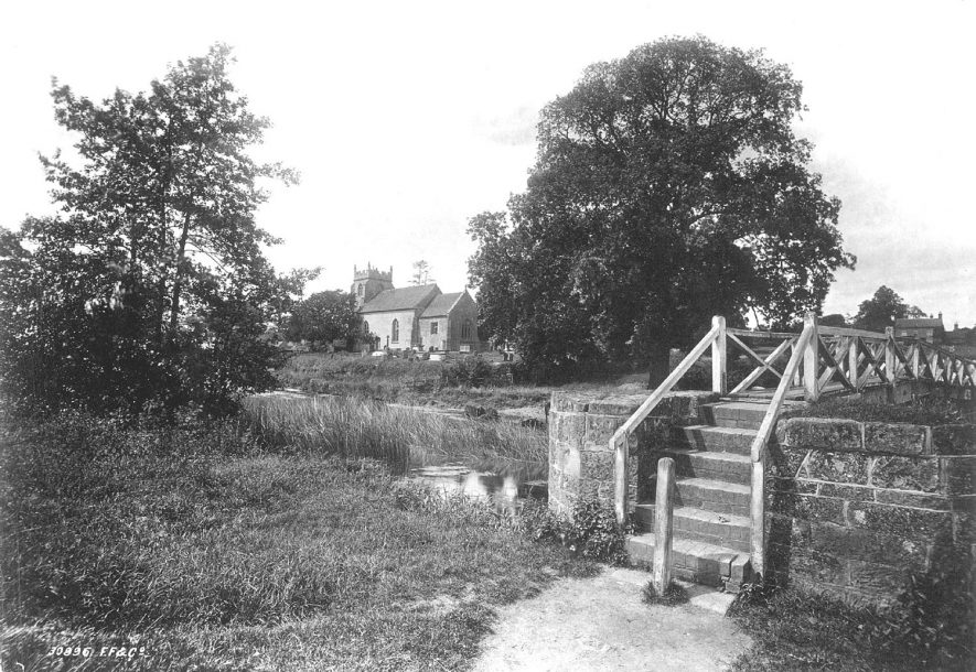 The Assumption of Our Lady Church and the footbridge over the River Avon, Ashow.  1890s |  IMAGE LOCATION: (Warwickshire County Record Office)