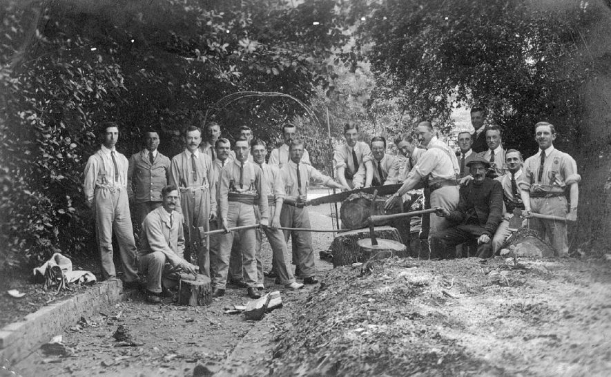 Group of men with felled tree, axes and saw. Not professional tree fellers. Lower Brailes.  1910s |  IMAGE LOCATION: (Warwickshire County Record Office)