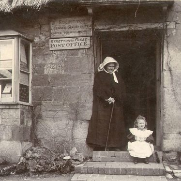 Stretton on Fosse.  Post Office, lady and child outside