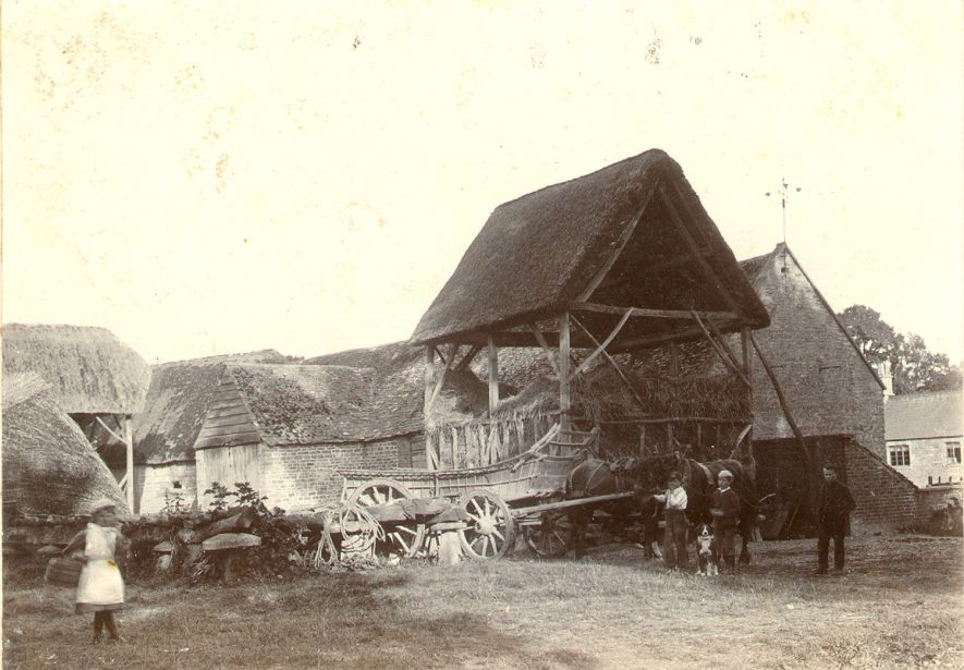 Horse and cart in front of thatched hay barn, with workers at Cherington.  1895 |  IMAGE LOCATION: (Warwickshire County Record Office)